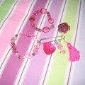 bracelets, bague et broche roses