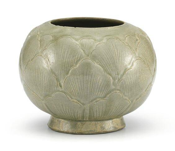 A carved Yue celadon jar, Five Dynasties (907-960)