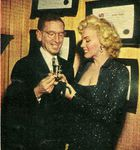 1952_10_Marilyn_and_George_Delacorte_at_Modern_Screen_Party__Oct