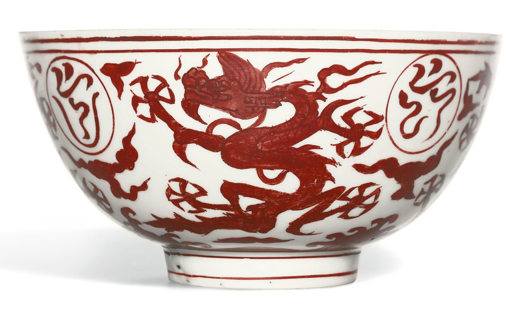 A very rare iron-red painted 'dragon' dish, mark and period of Jiajing