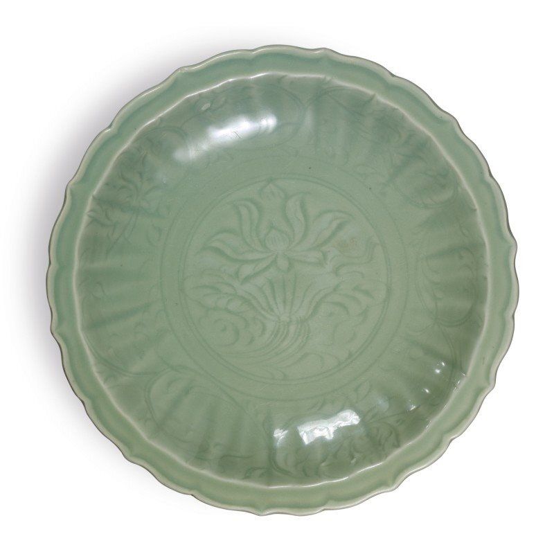 A 'Longquan' celadon-glazed molded 'lotus' barbed-rim charger, Ming dynasty, 15th-16th century