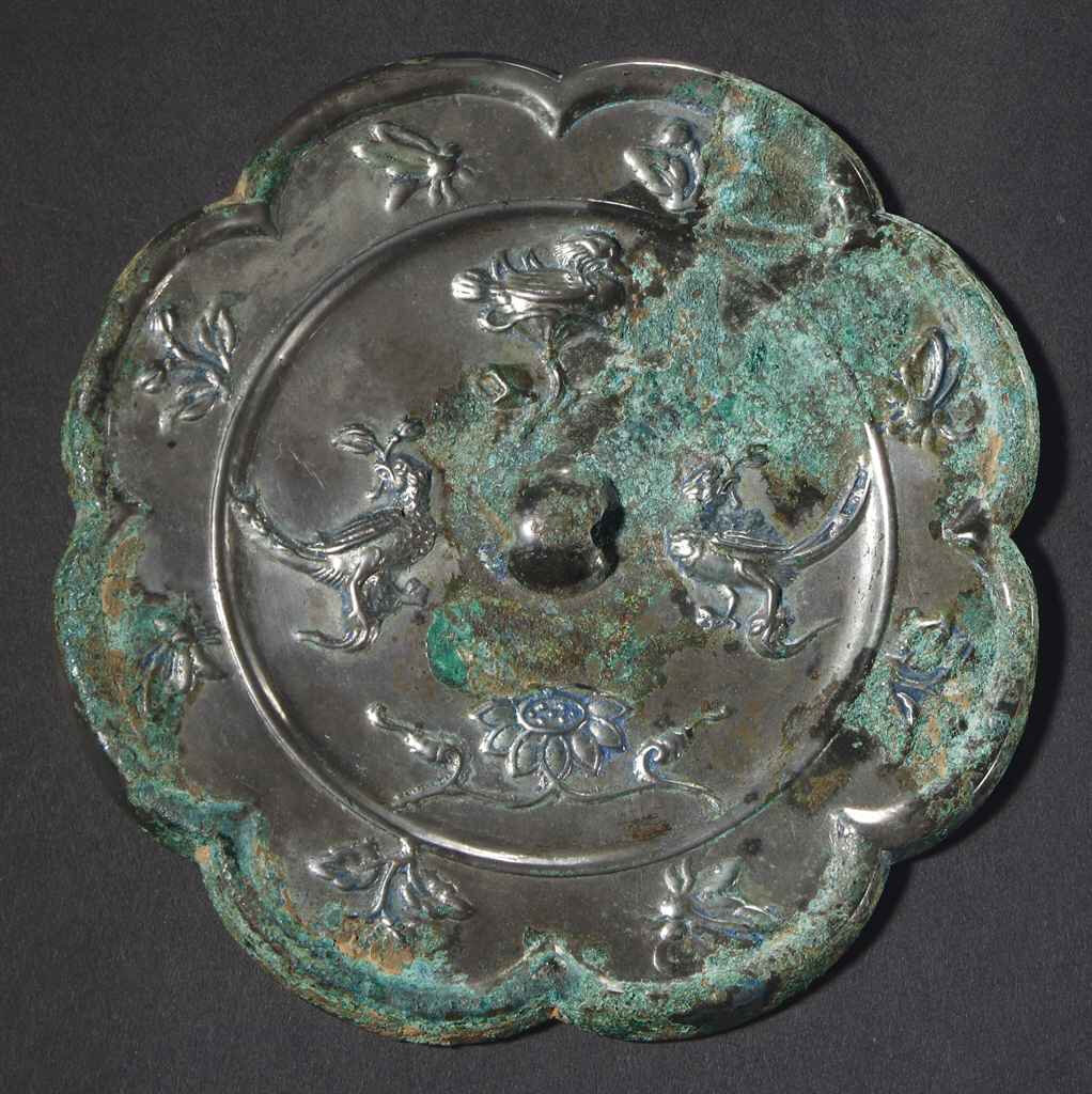 A silvered grey bronze eight lobered mirror, Tang dynasty (618-907)