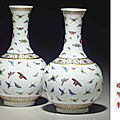 A pair of famille rose 'butterfly' vases, guangxu six-character mark in iron red and of the period (1875-1908)