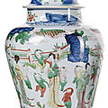 A wucai porcelain jar and cover with playing boys and ladies in a garden landscape, china, transitional period