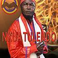 Kongo dieto 3858 : pourquoi nlongi'a kongo porte parfois une bande rouge sur sa tete ?
