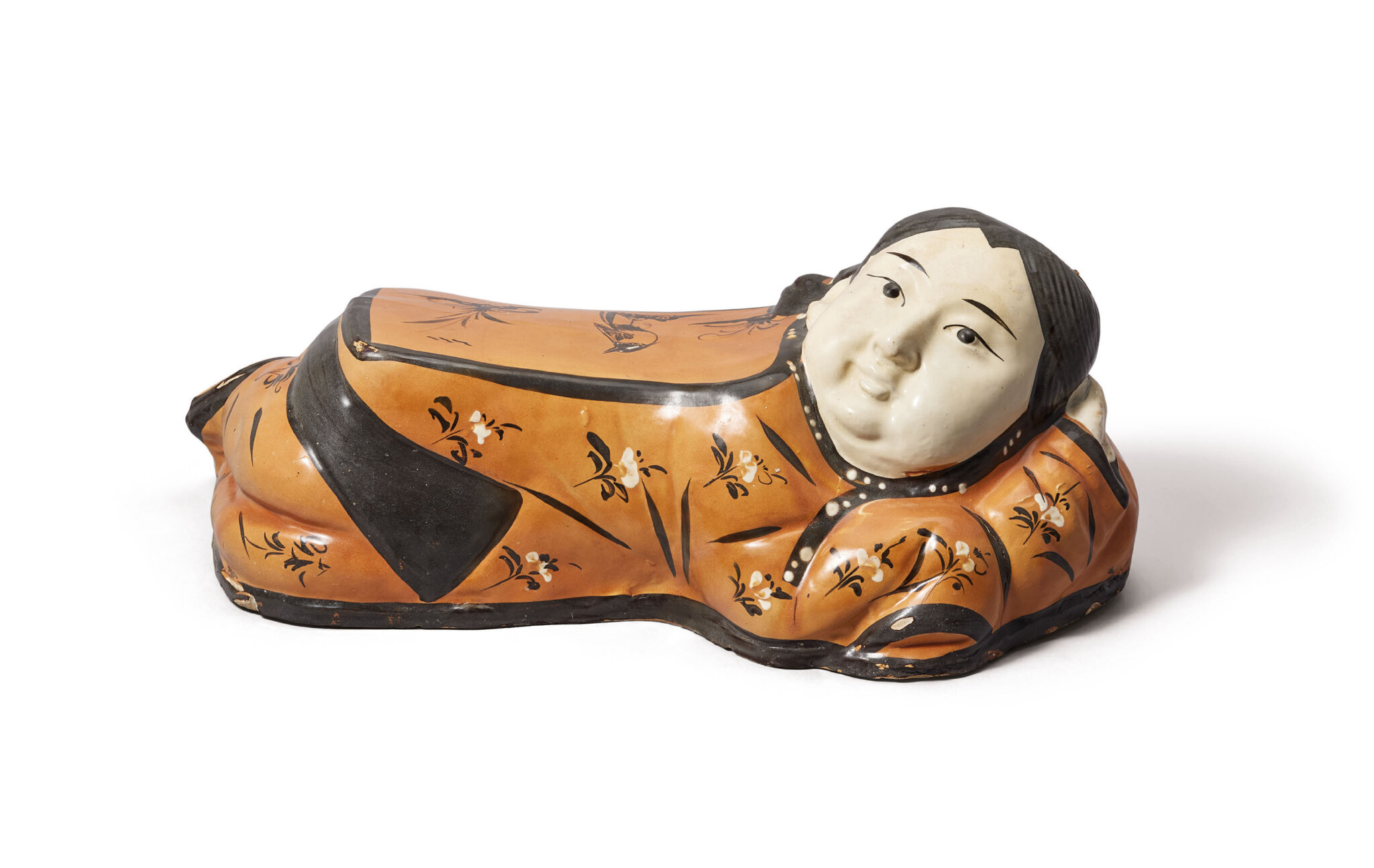 A painted Cizhou 'lady' pillow, Jin dynasty, 12th-13th century
