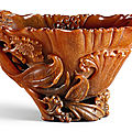 A rare and finely carved rhinoceros horn 'Cockscomb' libation cup, Qing dynasty, 18th century