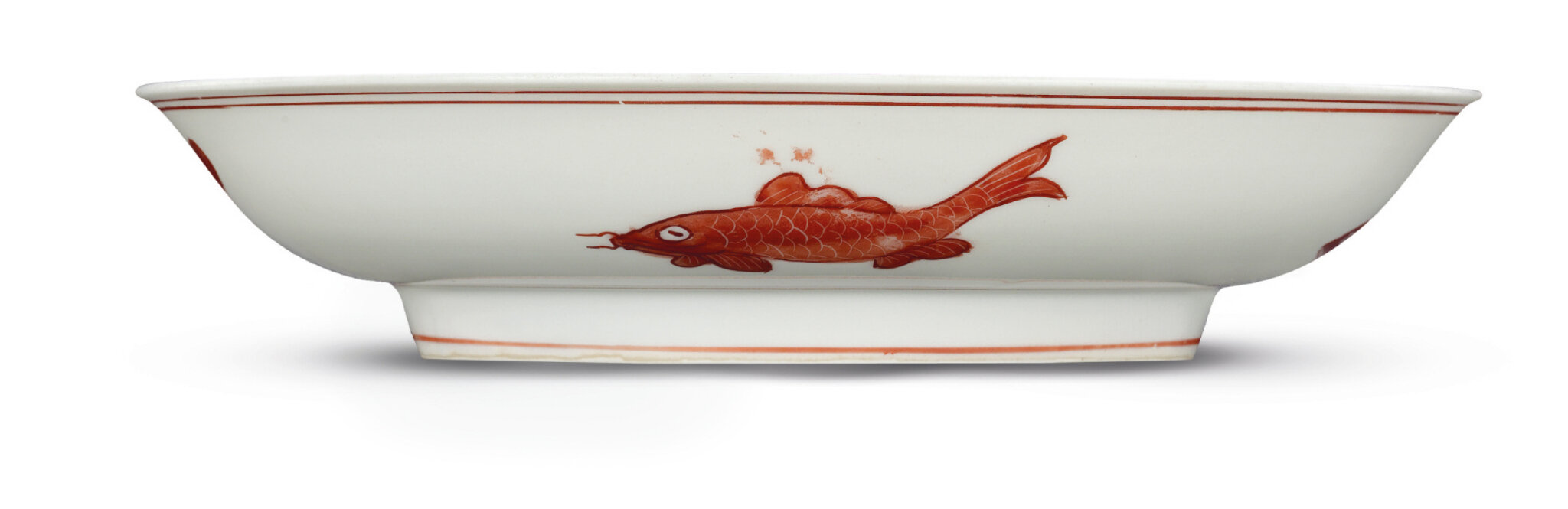 A rare Ming iron-red decorated 'fish' dish, Hongzhi-Zhengde period (1488-1521)