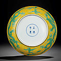 A yellow-ground green-enamelled 'Dragon' dish, Zhengde four-character mark within double-circles and of the period (1506-1521) (2)