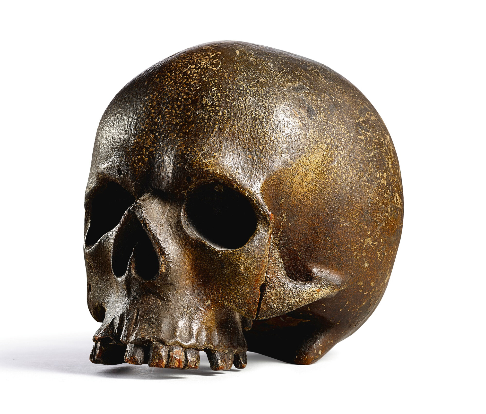 A carved wood memento mori skull, Germany, 16th century