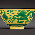 A green and yellow enamelled 'dragon and phoenix' bowl, kangxi six-character mark within double-circles and of the period