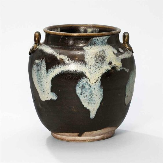 A Lushan phosphatic glaze-splashed brown-glazed jar, Tang dynasty (618-907)