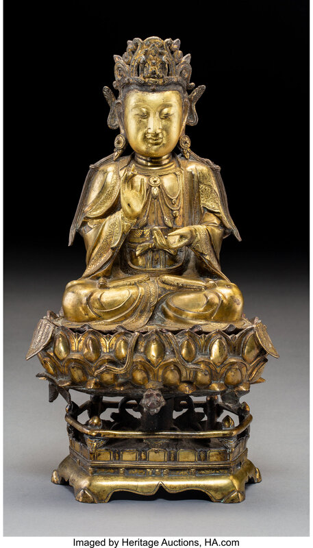 A Chinese Gilt Bronze Guanyin Figure on Stand, late Ming Dynasty