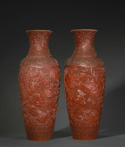 A pair of large carved cinnabar lacquer baluster vases, Qianlong marks, 19th century