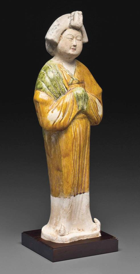 A sancai-glazed pottery figure of a court lady, Tang dynasty (AD 618-907)