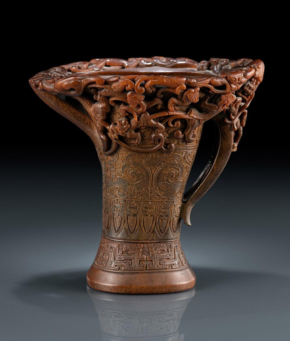 An exceptional and very rare rhinoceros horn ewer with chilong and dragon handle, Ming dynasty