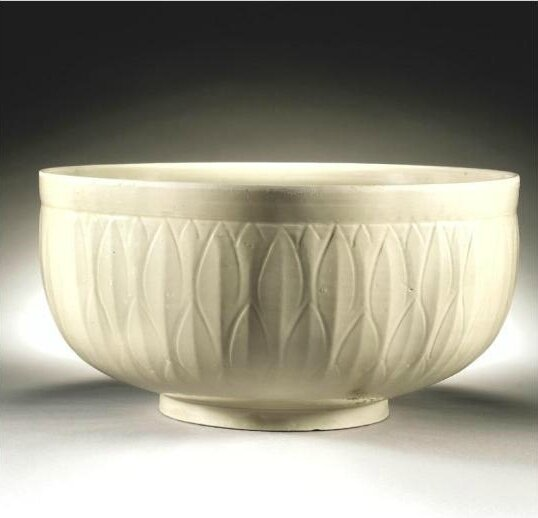 A magnificent and very rare carved 'Ding' Basin, Northern Song - Jin Dynasty, 11th-12th Century