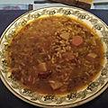 Soupe de riz et pommes de terre aux saucisses