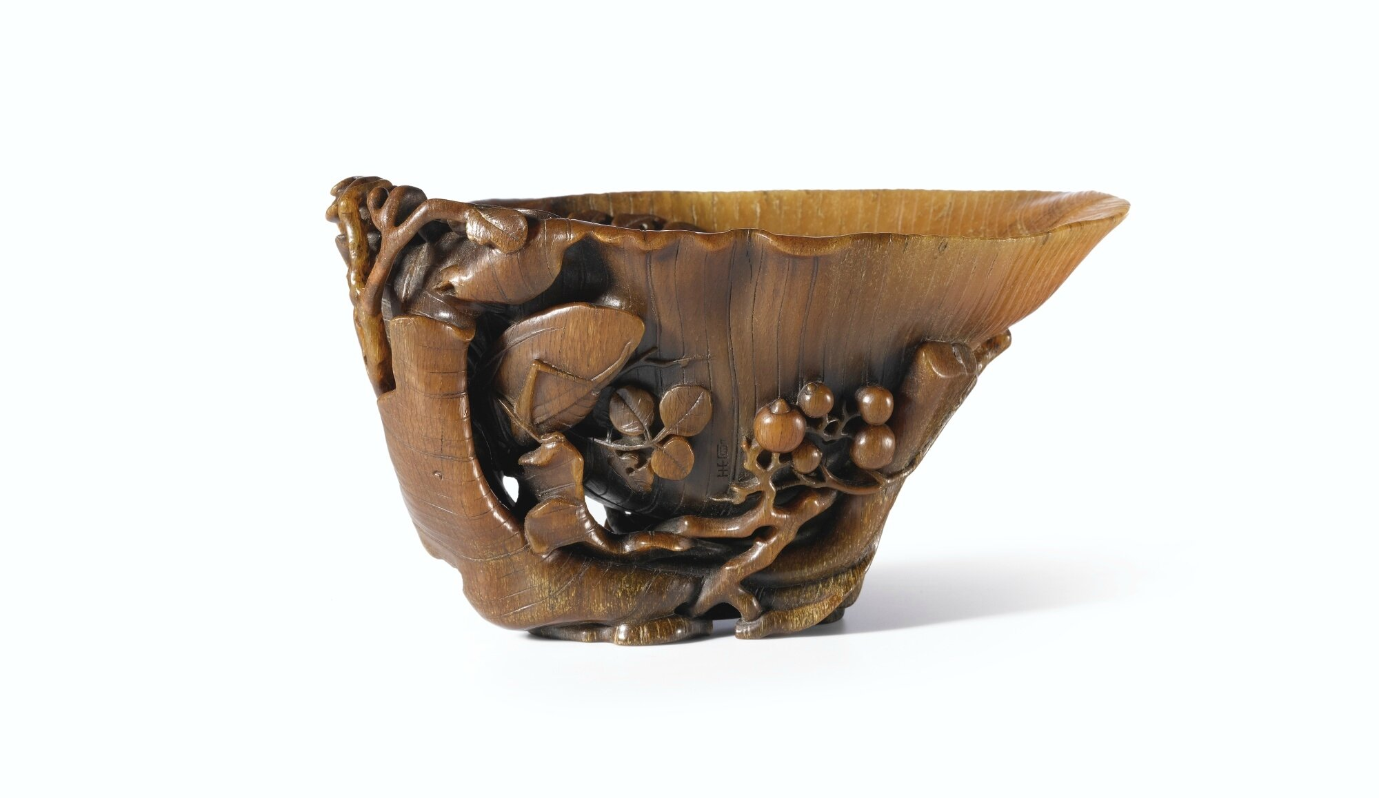 A Carved Rhinoceros Horn 'Plantain' Cup by You Kan, Qing Dynasty, Kangxi Period (1662-1722)