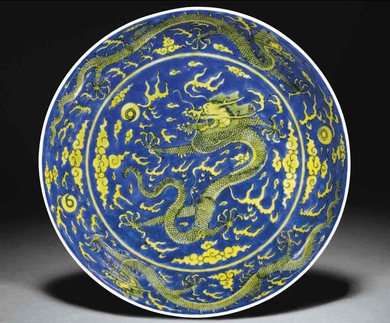 A yellow-glazed blue-ground 'Dragon' dish, Qianlong six-character seal mark in underglaze blue and of the period (1736-1795)