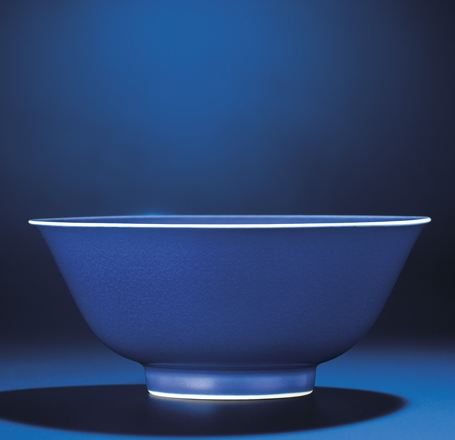 A fine blue-glazed bowl, Qianlong six-character seal mark and of the period (1736-1795)