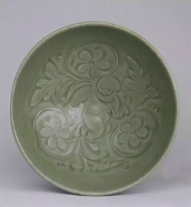 A Yaozhou carved 'Boy amoung lotus' bowl, Song dynasty, high 8