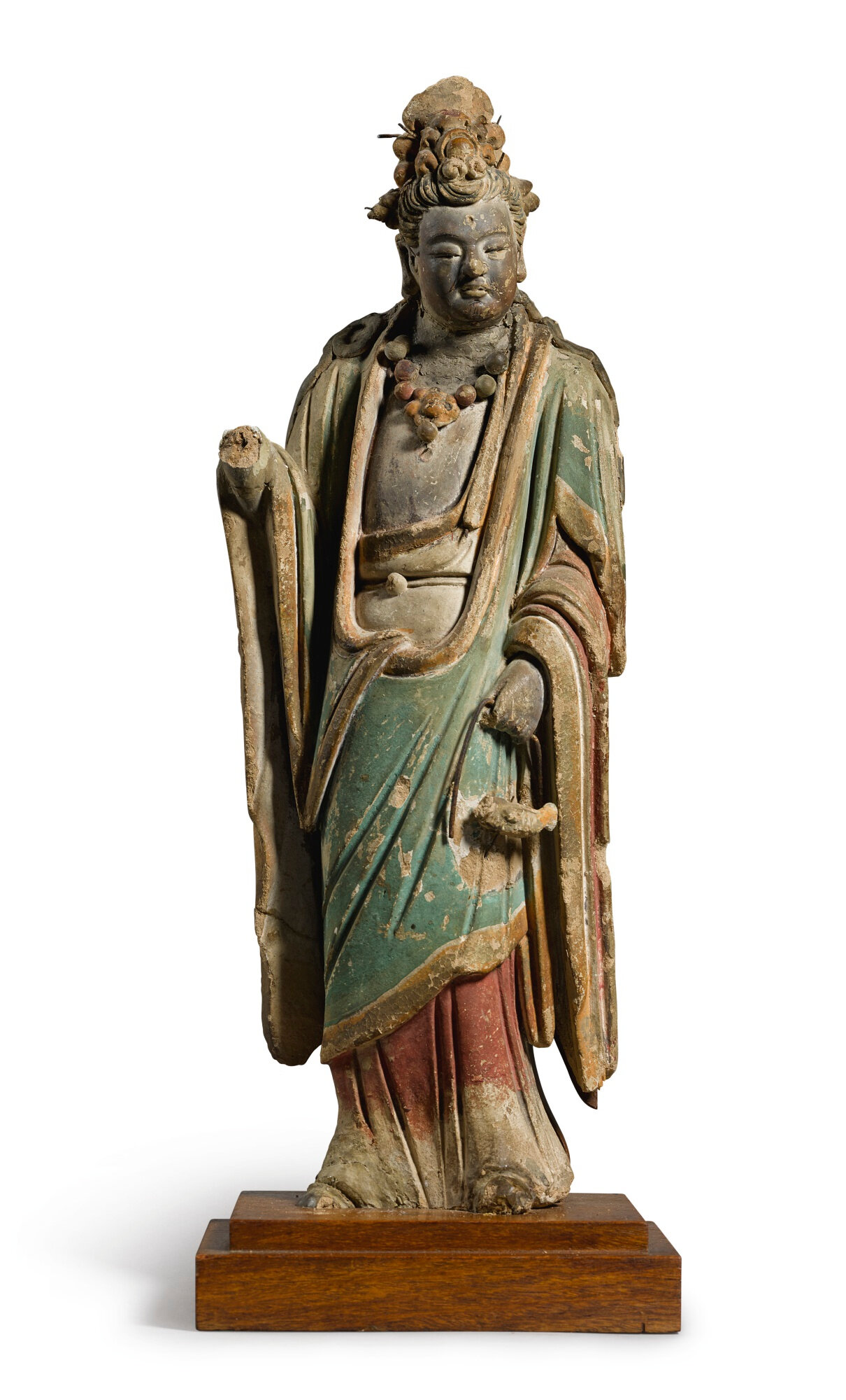A polychrome painted stoneware figure of Guanyin, Yuan-Ming dynasty (1271-1644)