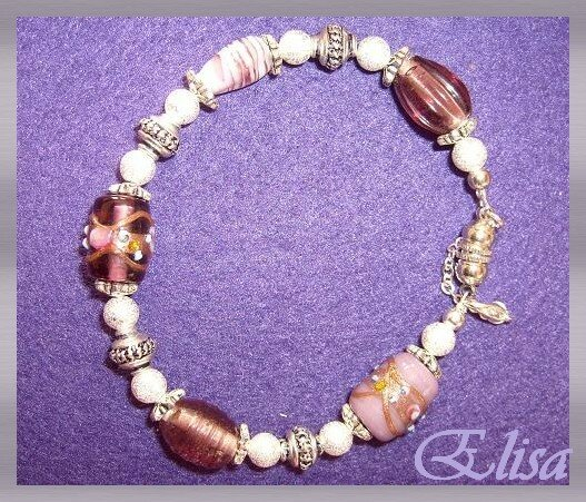 un enfilage simple à partir de jolies perles! merci Topine!