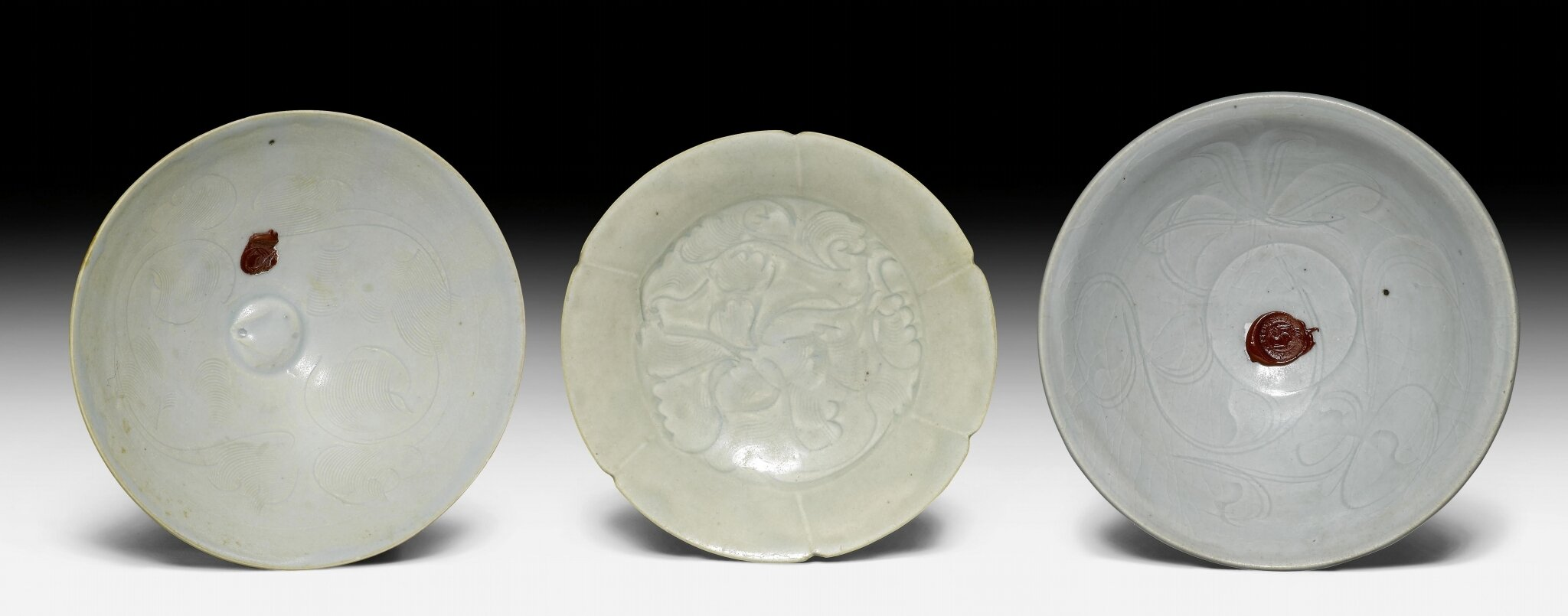 Three Qingbai glazed dishes with incised and combed floral designs, China, Southern Song dynasty