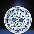 A large early Ming blue and white 'Peony' charger, Yongle period (1403-1425)