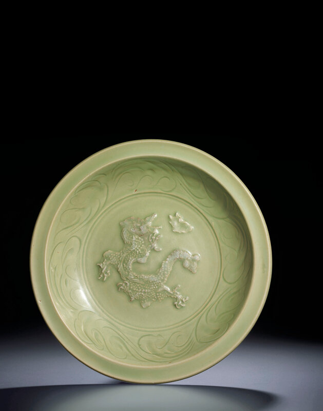 A Longquan celadon carved and moulded 'Dragon' dish, Yuandynasty (1279-1368)
