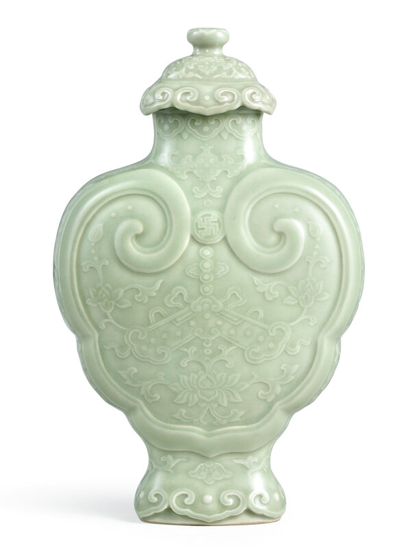 A rare moulded and carved celadon-glazed 'Ruyi' vase and cover, seal mark and period of Qianlong (1736-1795)