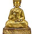 A large gilt-copper repoussé figure of padmasambhava. tibet, 17th century