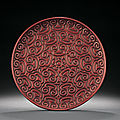 A rare large red tixi lacquer circular dish, ming dynasty, 15th century