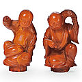 A pair of small amber carvings of the hehe erxian, 18th century