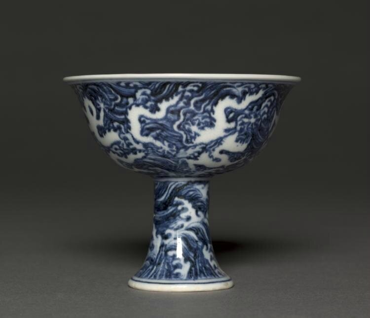Stem Cup, Xuande mark and period (1426-1435), Ming dynasty (1368-1644), China, Jiangxi province, Jingdezhen , porcelain with reversed underglaze blue and incised decoration, Diameter - w:10.10 cm (w:3 15/16 inches) Overall - h:9.00 cm (h:3 1/2 inches). Se