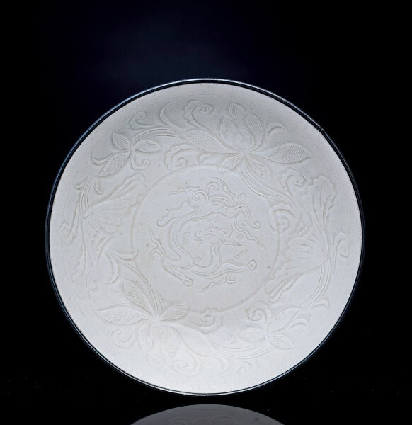 A Rare and Finely Carved Ding Dragon Dish, Northern Song Dynasty, 10th-12th Century