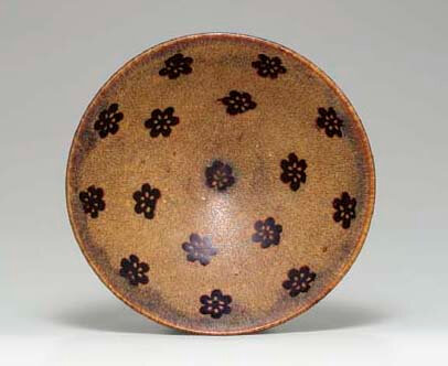 A rare 'Jizhou' paper cut resist-decorated conical bowl, Southern Song dynasty, 12th-13th century