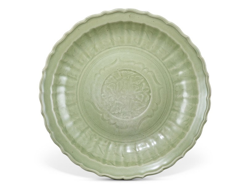 A Longquan celadon barbed 'peony' charger, Yuan-early Ming dynasty