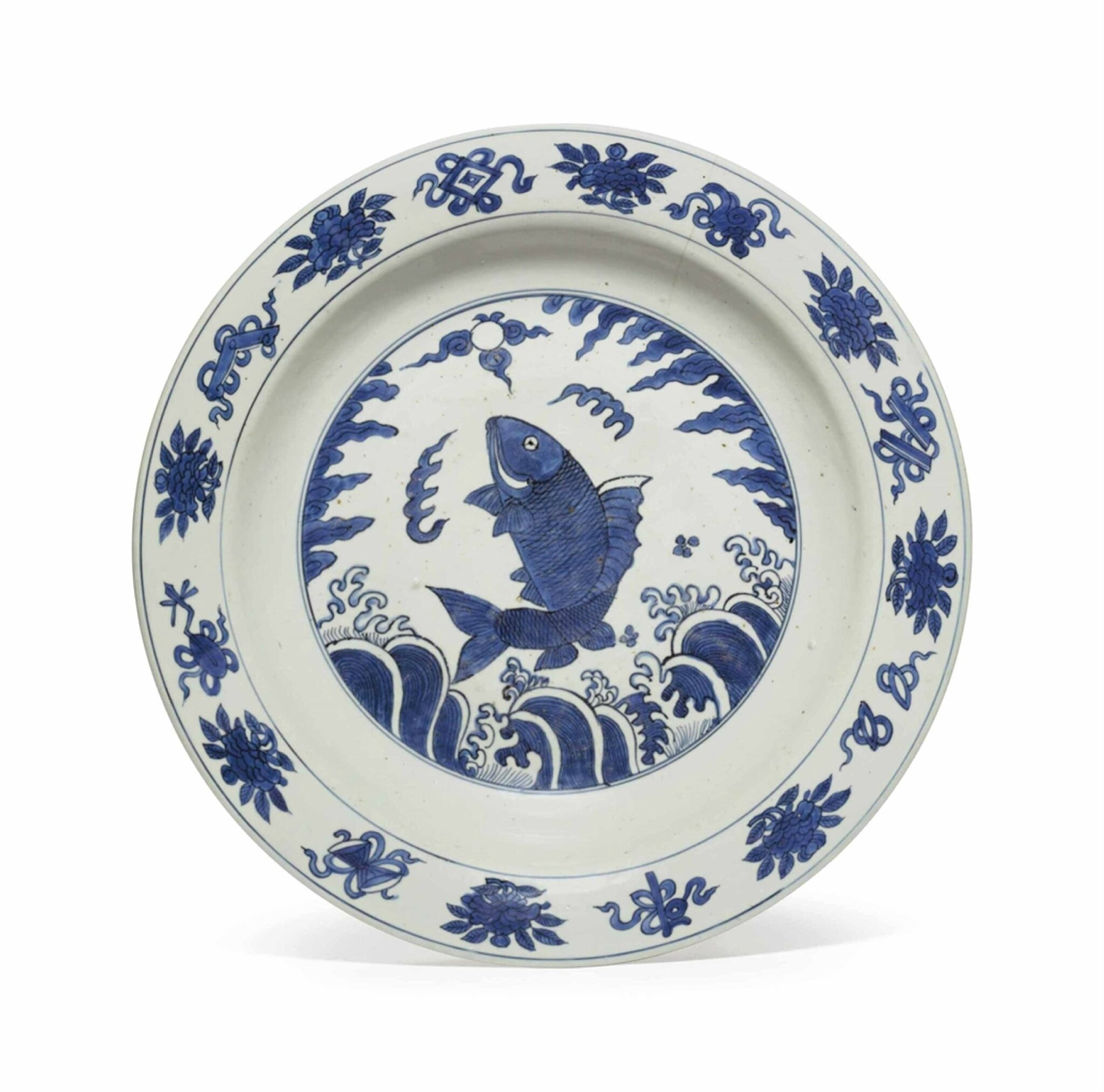 A large blue and white 'fish' dish, Ming Dynasty, 16th-17th century