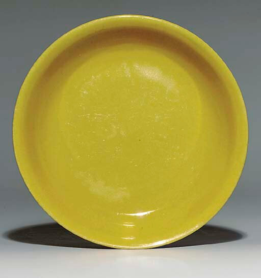 A yellow-glazed saucer dish, underglaze-blue Jiajing six-character mark within a double circle and of the period (1522-1566)