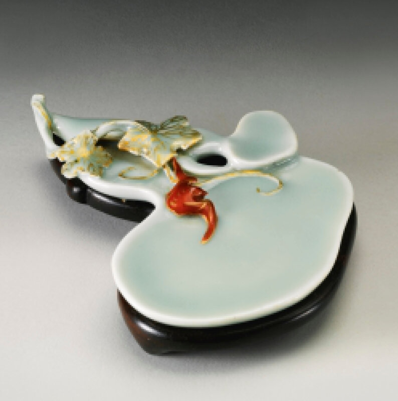 A rare celadon-glazed iron-red and gilt-embellished double-gourd shaped ink palette, Qianlong sealmark and period (1736-1795)