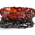 A superbly carved amber 'prunus' washer, qing dynasty, 18th century