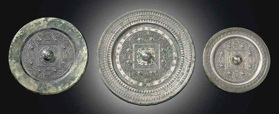 Three bronze 'TLV' circular mirrors, Western Han dynasty (206BC-8 AD);