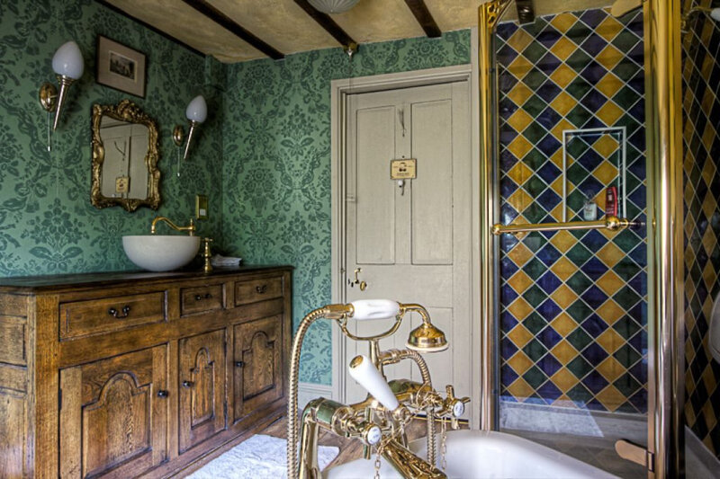 amazing-victorian-bathroom-with-wallpaper-and-wooden-vanity-cabinet