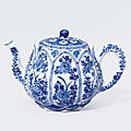 A rare small blue and white 'lotus' teapot and cover, kangxi period (1662-1722)