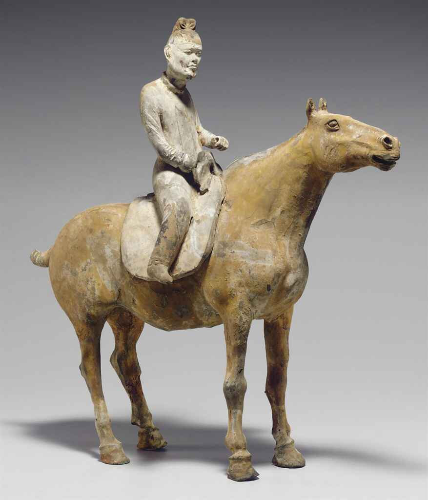 A rare painted grey pottery figure of an equestrian, Tang dynasty (618-907)