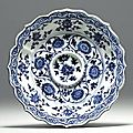A rare early ming blue and white petal-molded cup stand, hongwu period (1368-1398)