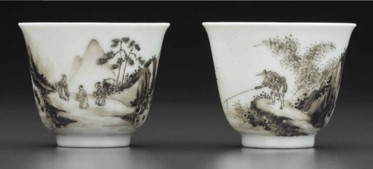 A rare pair of grisaille-decorated wine cups, Yongzheng six-character marks in underglaze blue within double circles and of the period (1723-1735)