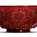 A carved transparent red glass bowl, qianlong incised four-character mark within a square and of the period (1736-1795)